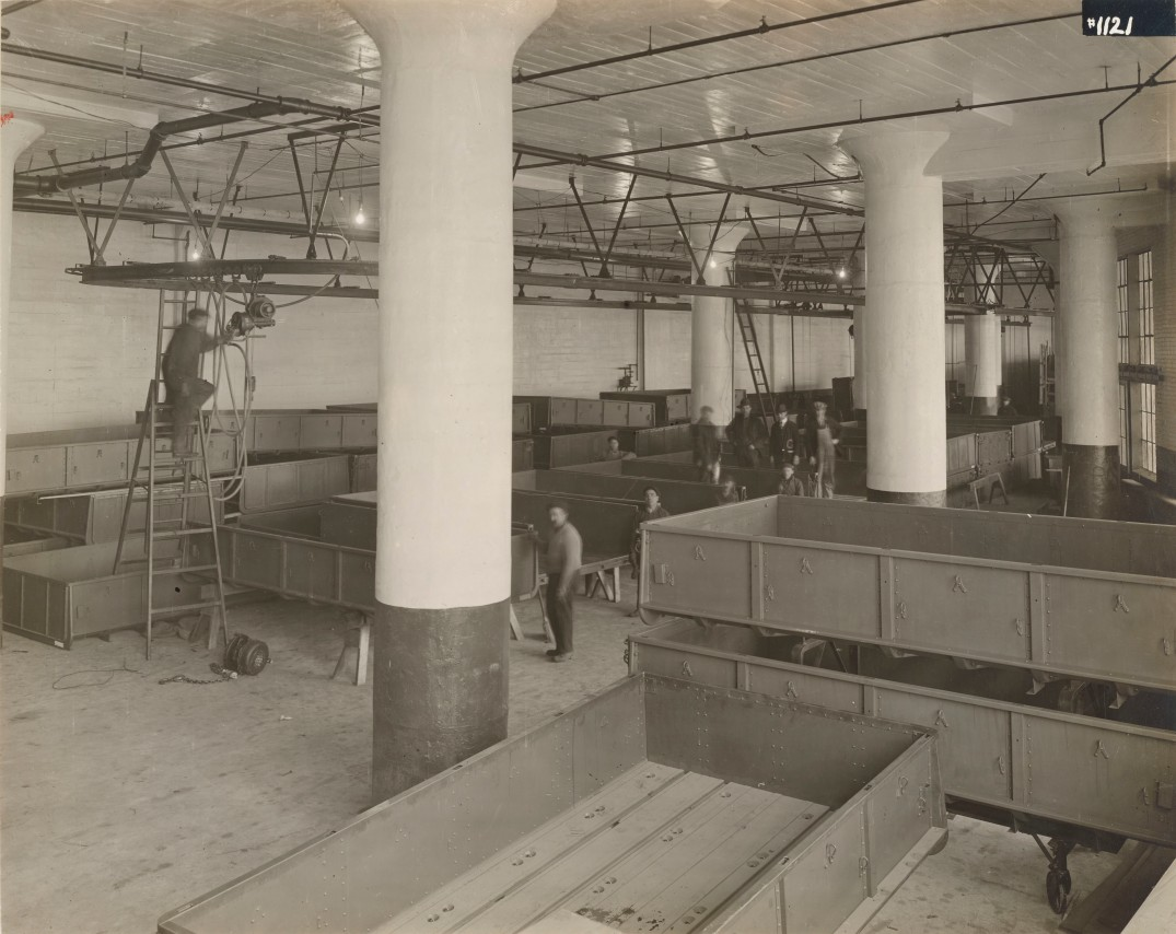 EDIT. Cargo bed bodies for 'Class B 2 M' being packed for shipment, E.G. Budd Mfg. Co., Philadelphia, PA. October 5th, 1918